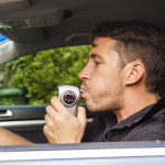 Man blowing in a breathalyzer